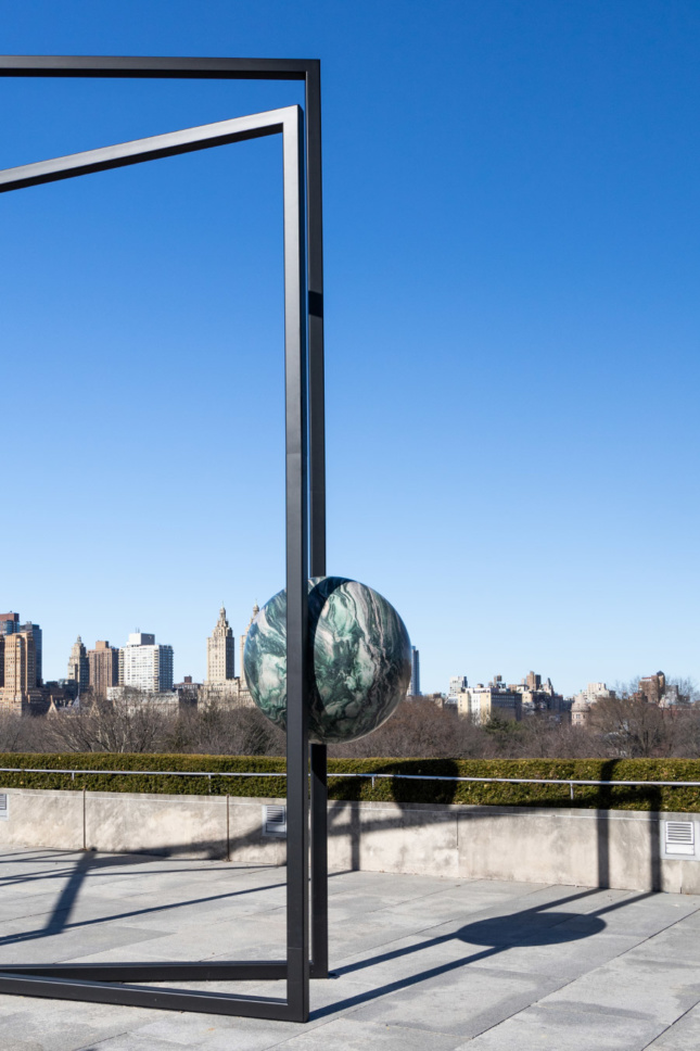 Photo of a suspended stone sphere in a sculpture on the Metropolitan Museum's rooftop in New York City