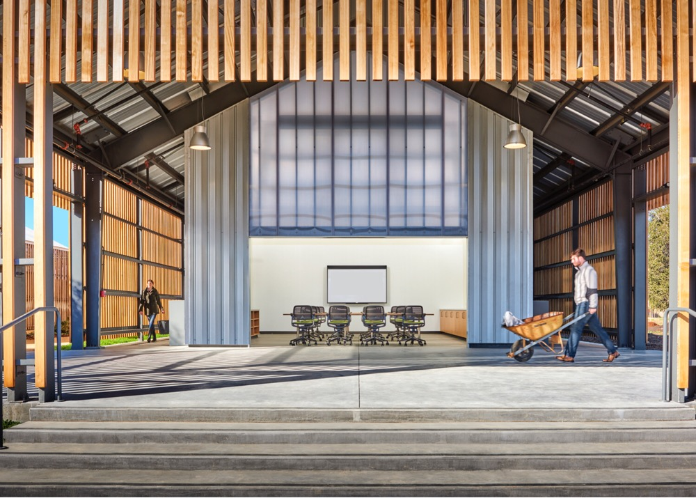 Photo of a barn-like building with an office space inside