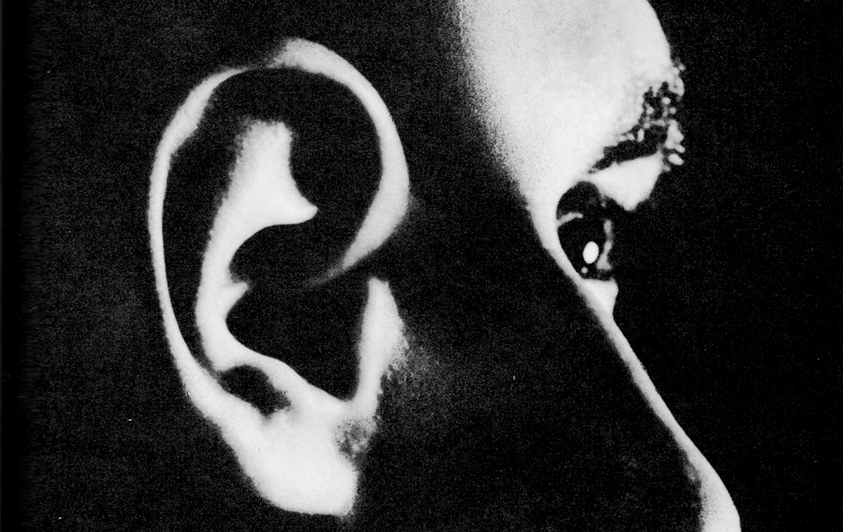Black and white photo collage of an ear, nose, and eye