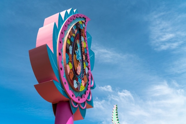 Photo of a brightly colored large sign in the shape of a paisley flower
