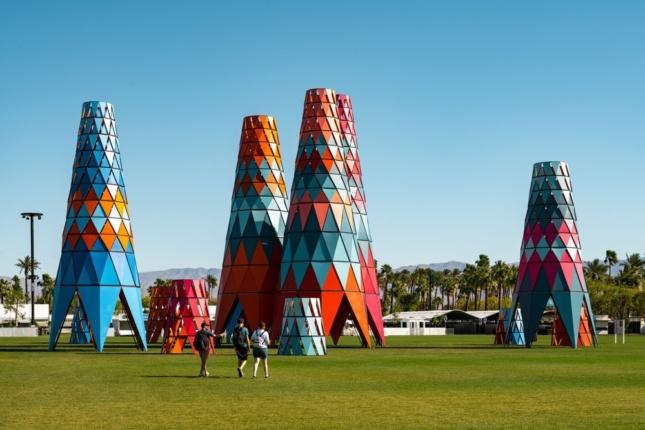 Photo of colored conical towers in a grassy field