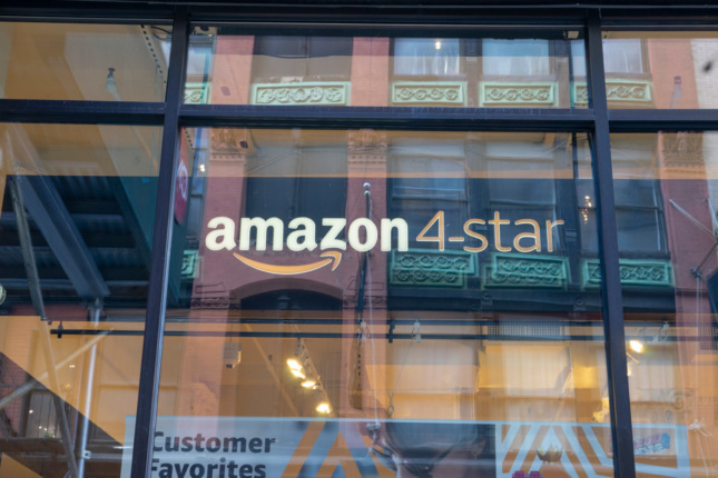 """Photo of a window sign that says """"Amazon 4-star"""""""