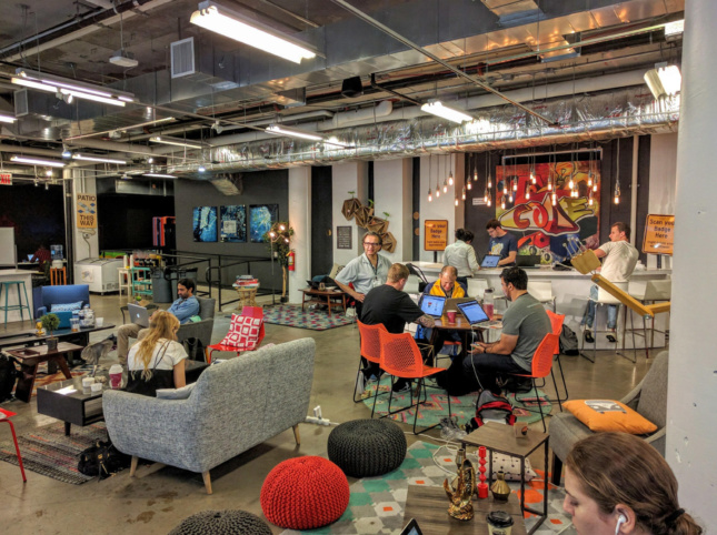 Photo of the interior photo of an industrial-style coworking space with pendant lights