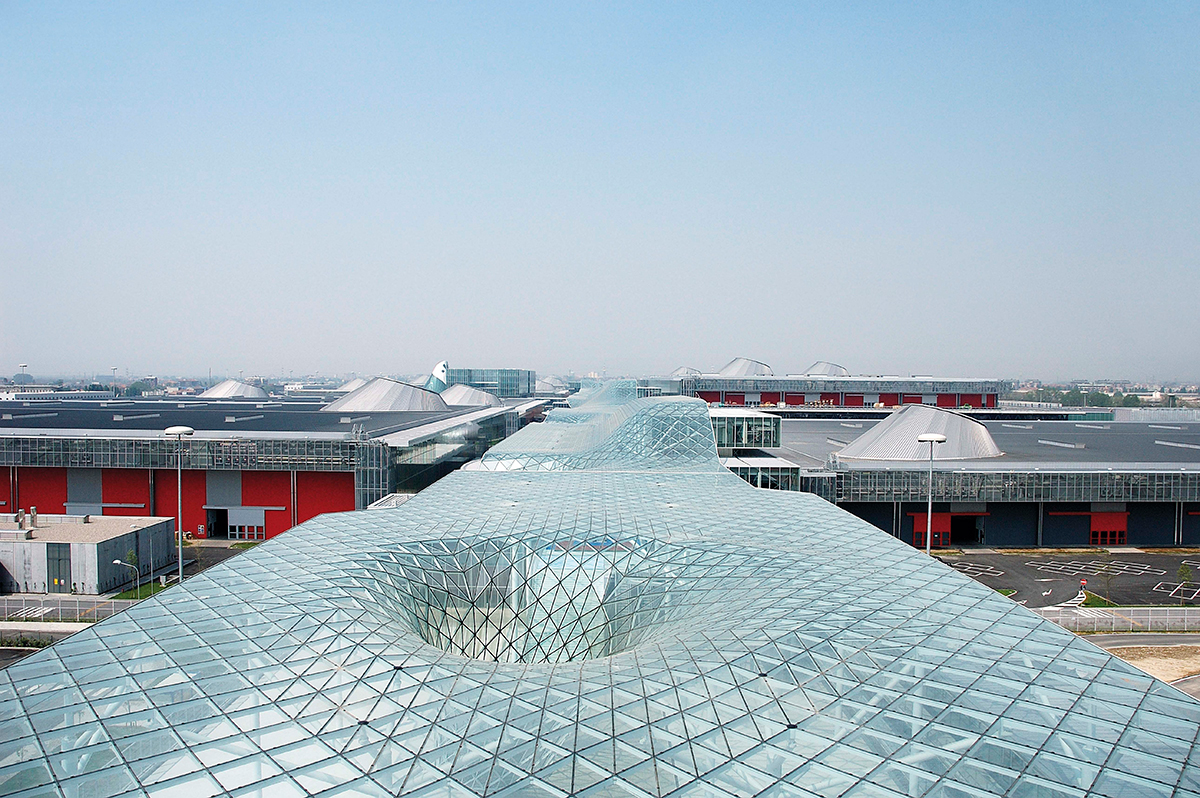 Image of undulating glass roof of convention center
