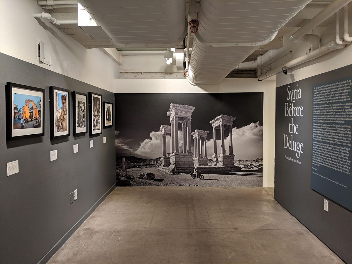 Photo of a small gallery interior with a photo on the wall and