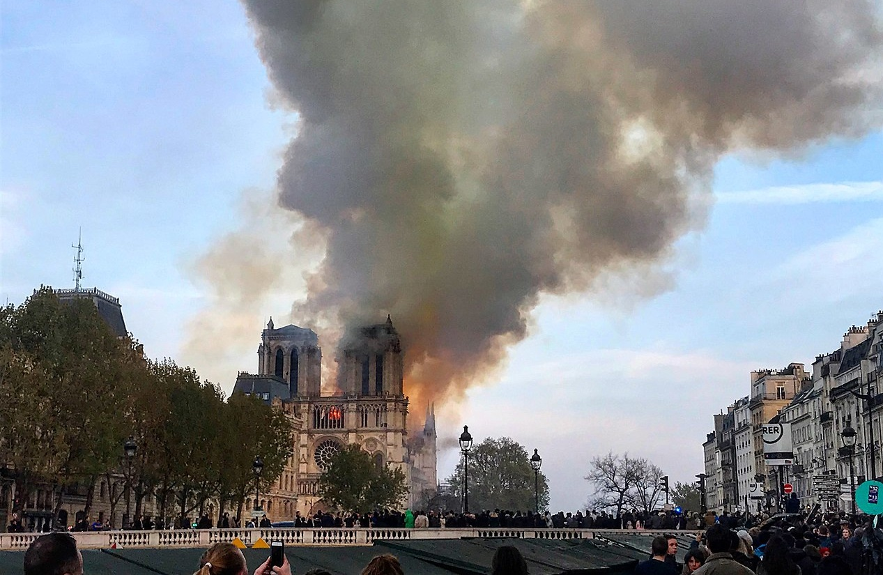 Photo of Notre Dame Cathedral on fire from a distance