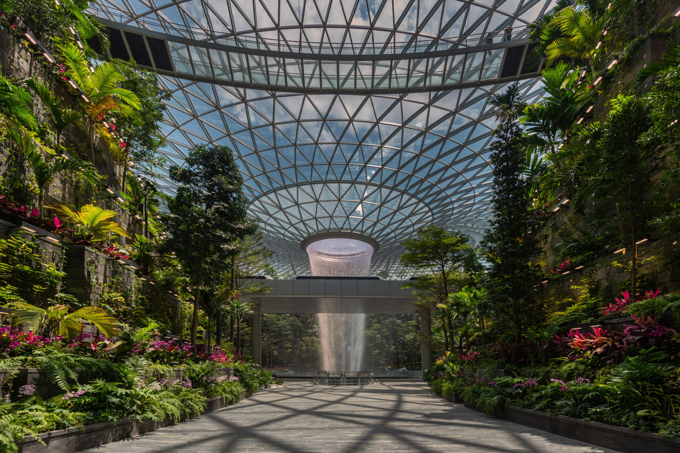 Photo of an indoor waterfall below a glass canopy