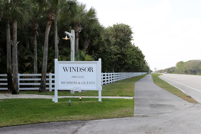"""Photo of the street sign for Windsor, Florida that says """"WINDSOR PRIVATE MEMBERS & GUESTS"""""""