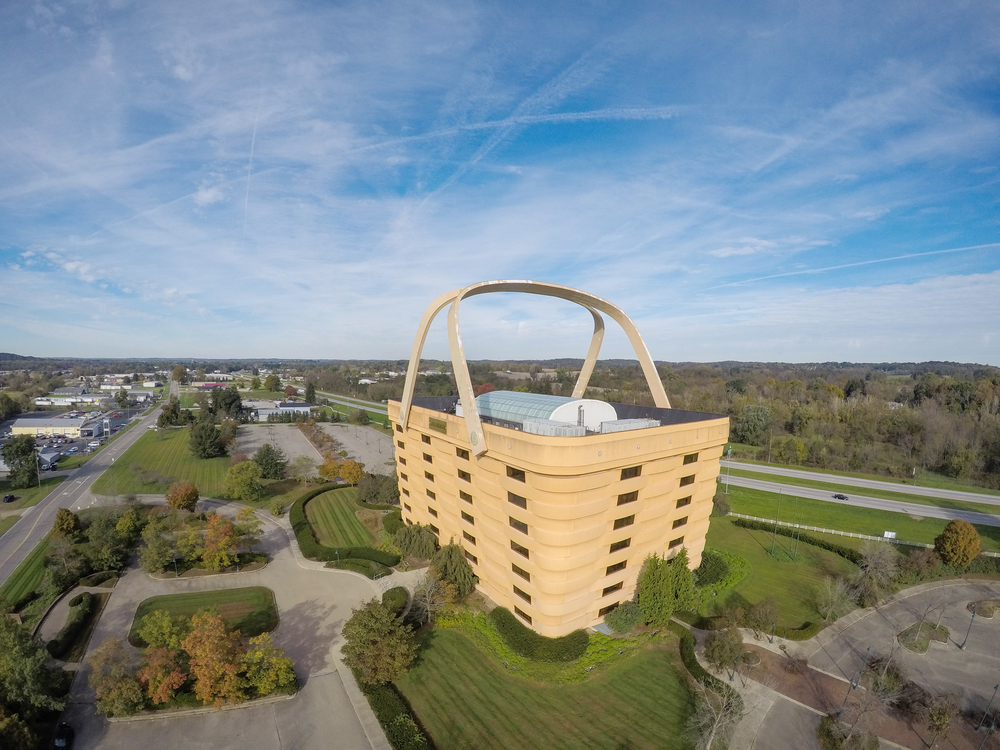 Photo of a large, basket-shaped building from above