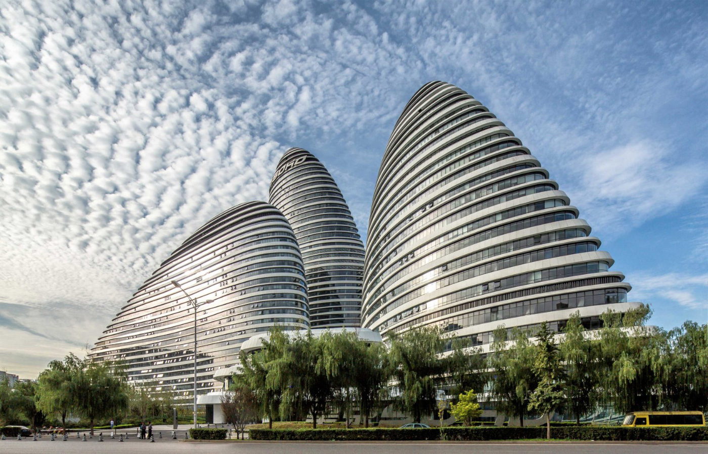 Photo of three rounded, pebble-shaped office towers against a clear sky