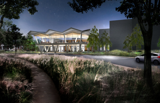 Nighttime rendering of landscape leading up to transparent museum