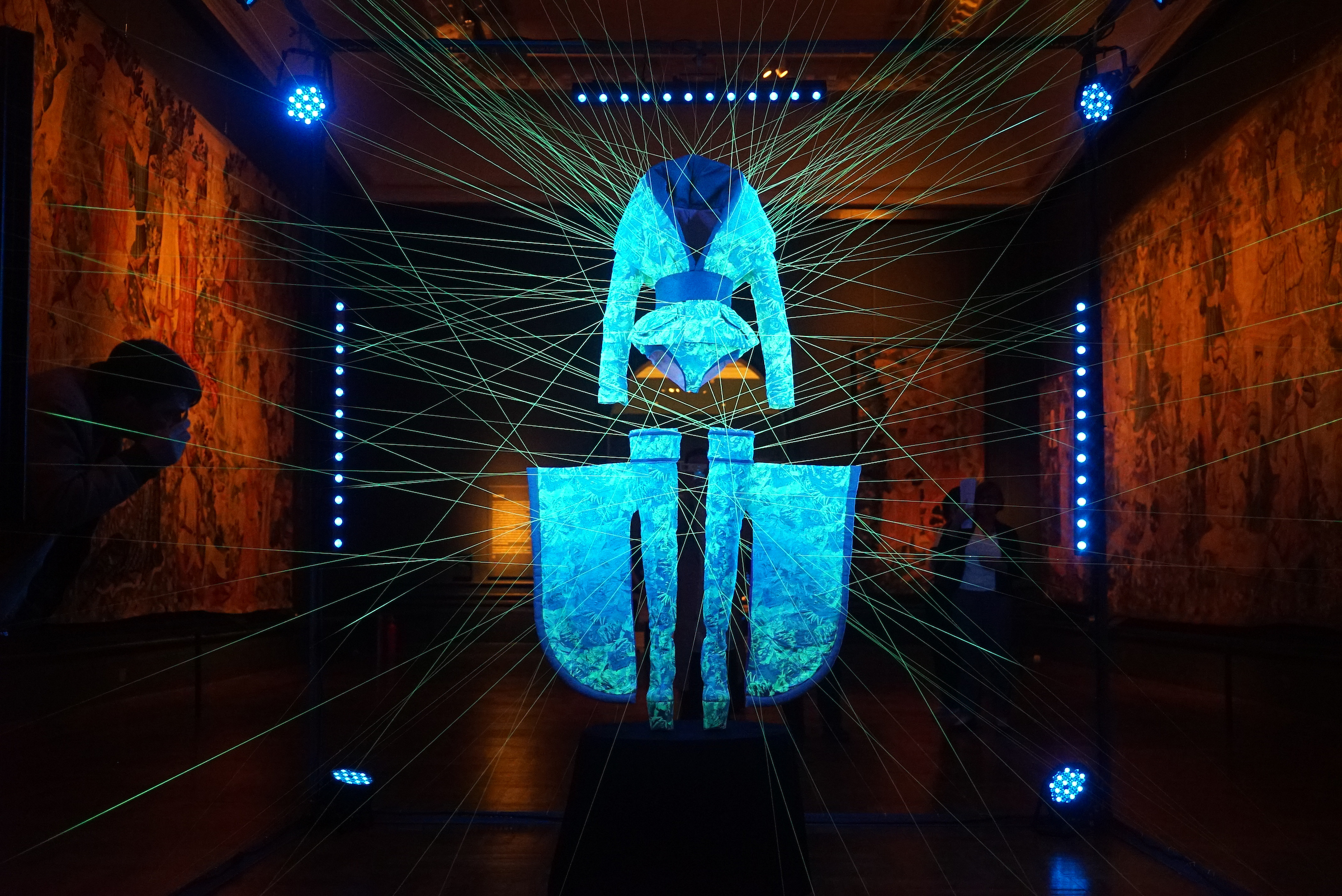 Photo of a suspended glowing silk outfit