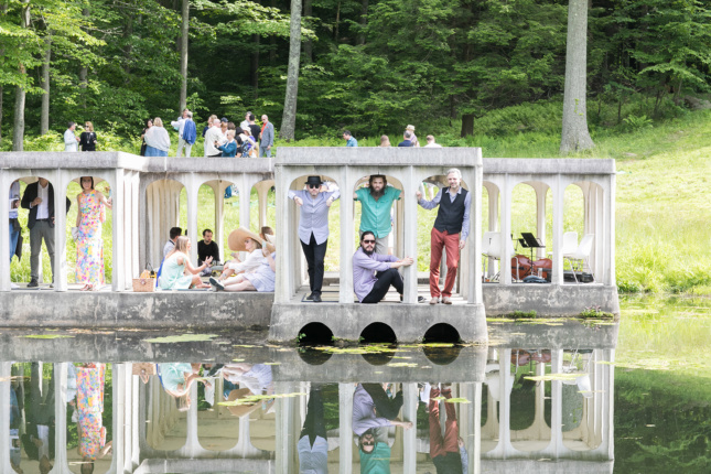 Photo of people hanging out in a pavilion on the grounds of the Glass House