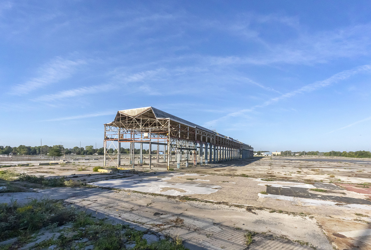Photo of An empty lattice structure on a barren industrial site