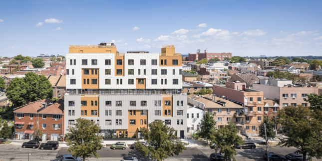 Photo of mid-rise affordable housing building in Queens