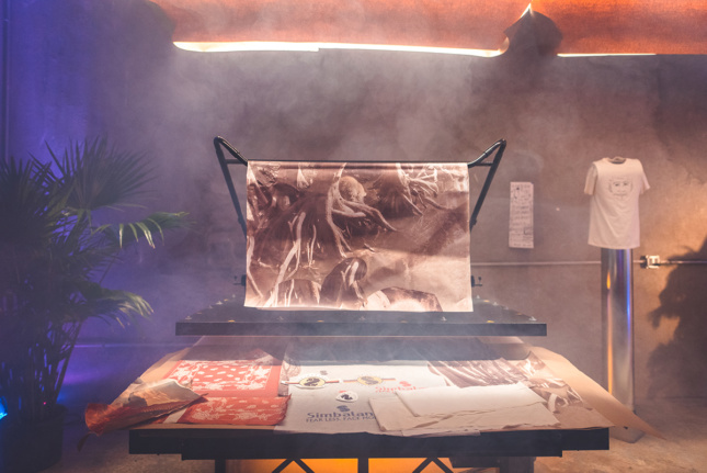 Photo of large prints piled on a table with fog rising from them