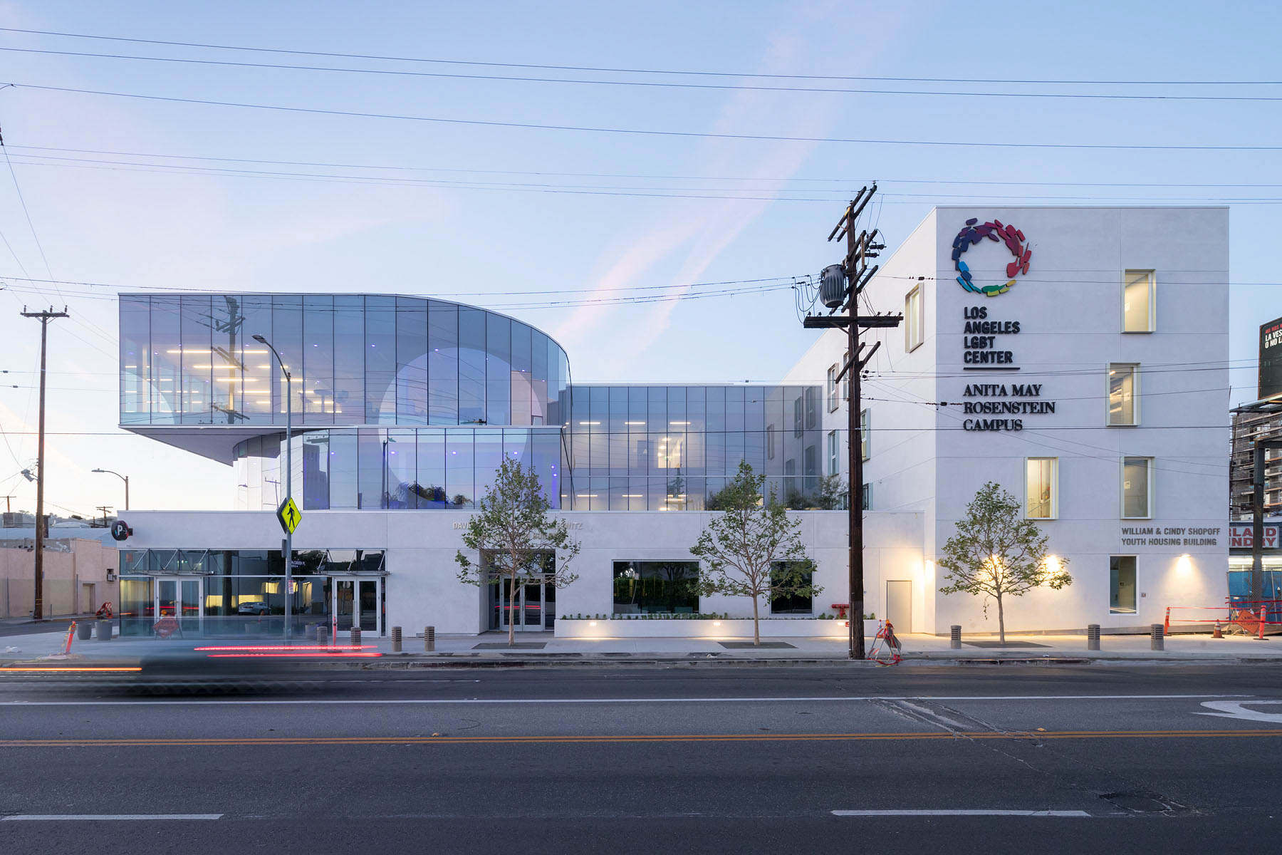 Photo of the Anita May Rosenstein Campus's street facade with glass and solid white forms