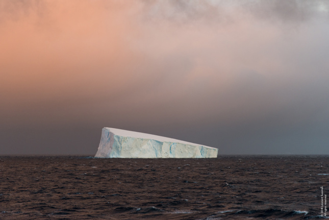 Photo of iceberg floating in the water