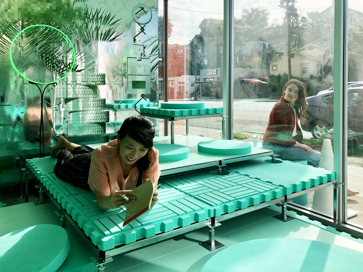 Image of teal-colored installation by EXTENTS in Los Angeles storefront window