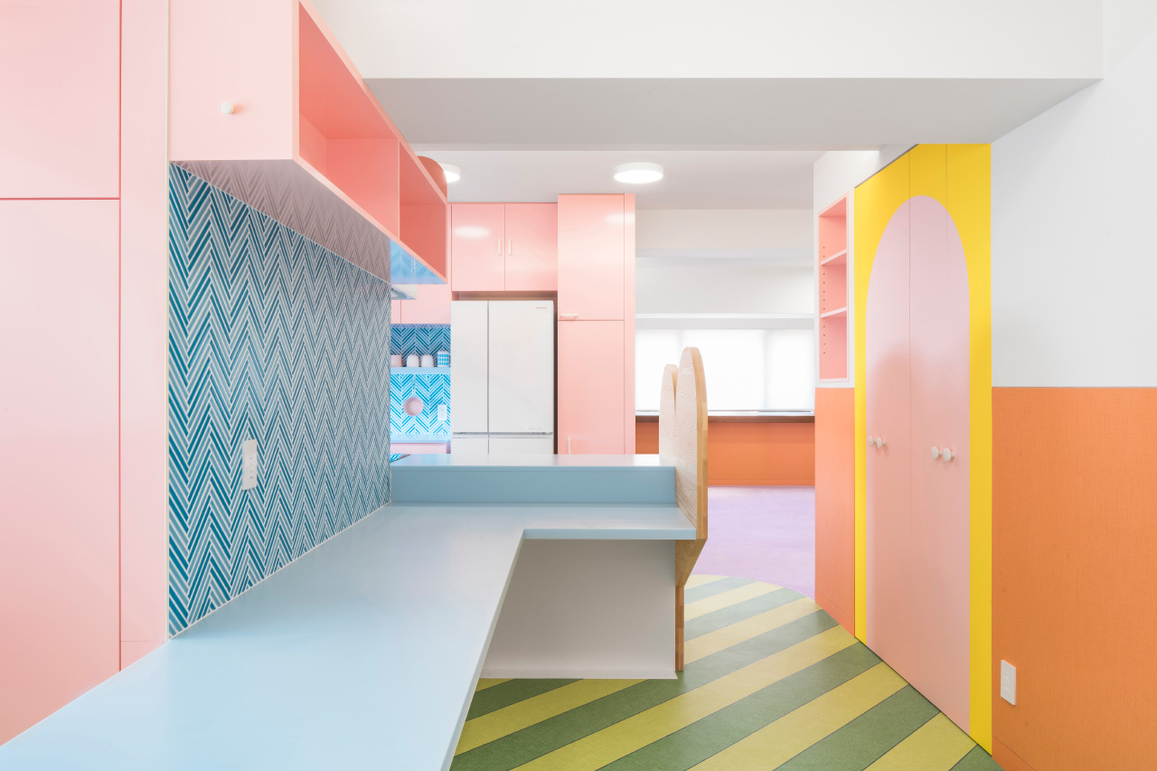Photo of a kitchen with brightly colored and patterned surfaces