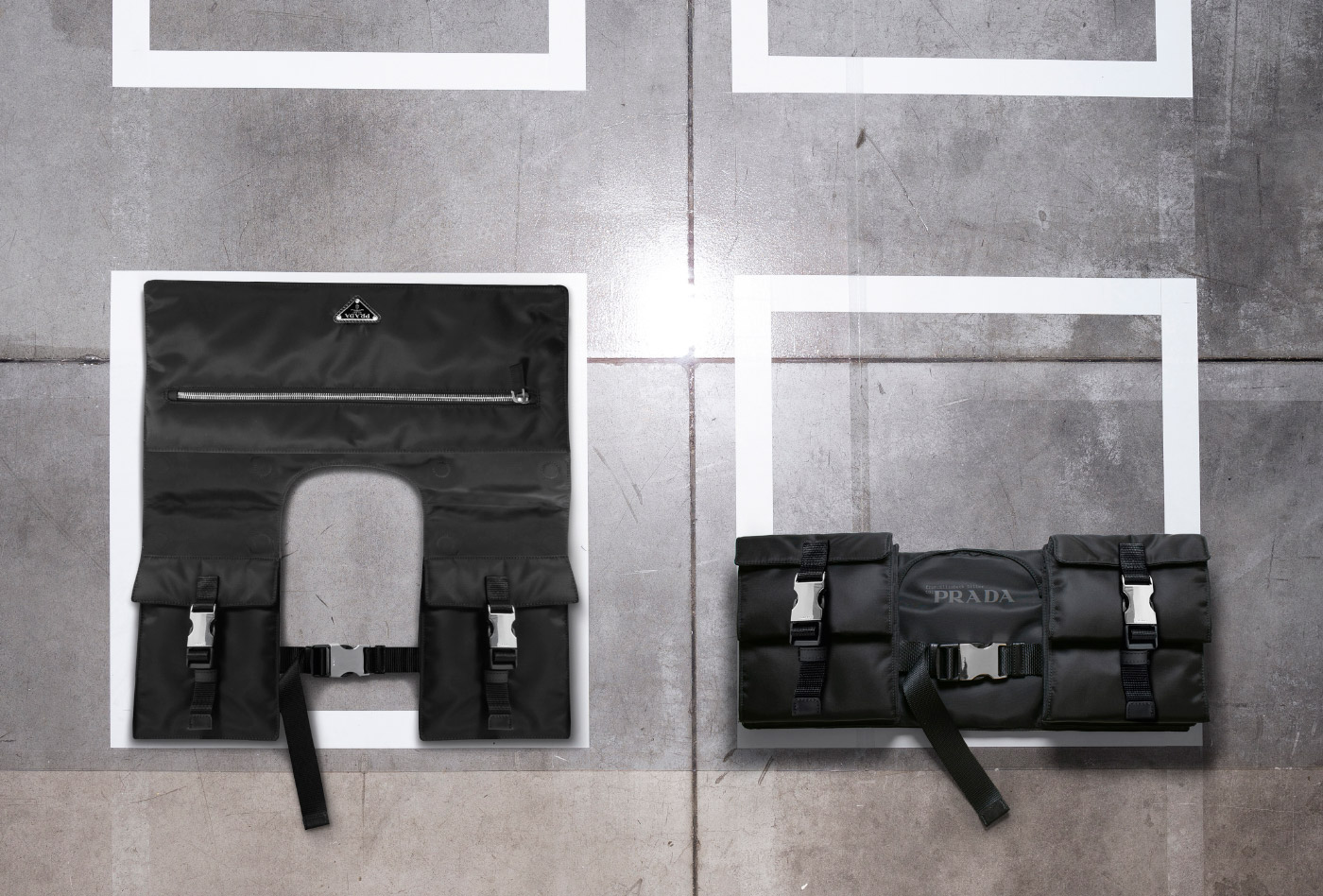 Photo of two black nylon bags on a concrete floor