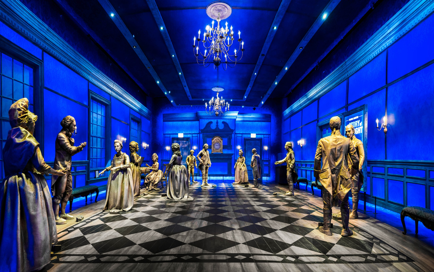 Photo of a blue ballroom with checkered floors and mannequins