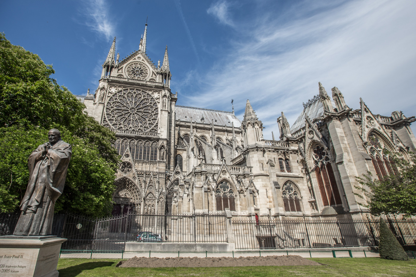 Photo of Notre Dame Cathedral in Paris: A limestone church with an enormous rose window