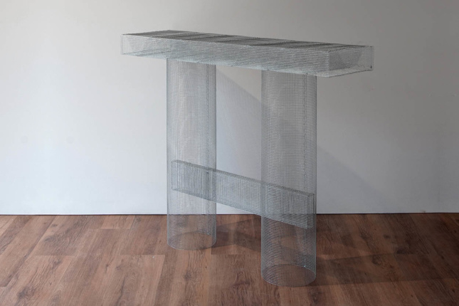 Photo of console table made of metal mesh
