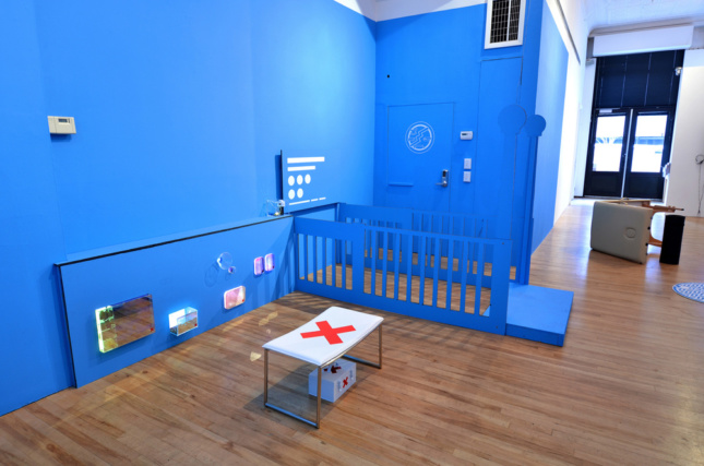 A blue-painted room with a white table in the center