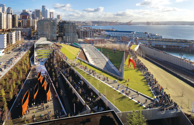 An aerial photo of a jagged elevated park on a waterfront in Seattle, designed by the New York firm Weiss/Manfredi