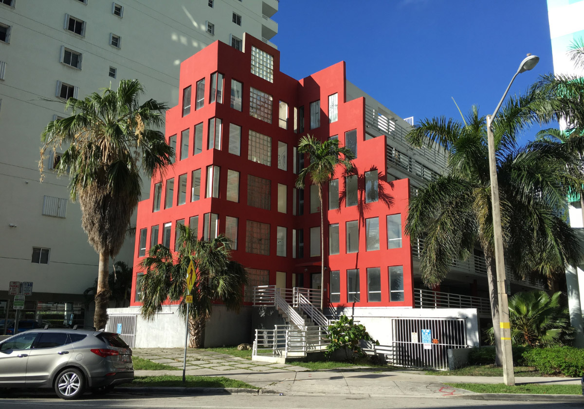 Photo of the Arquitectonica-designed Babylon, a 5-story, red, terraced apartment complex