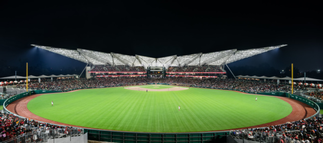 Wide-angle view of the new Diablos Rojos Stadium from the turf, looking towards covered stadium seating
