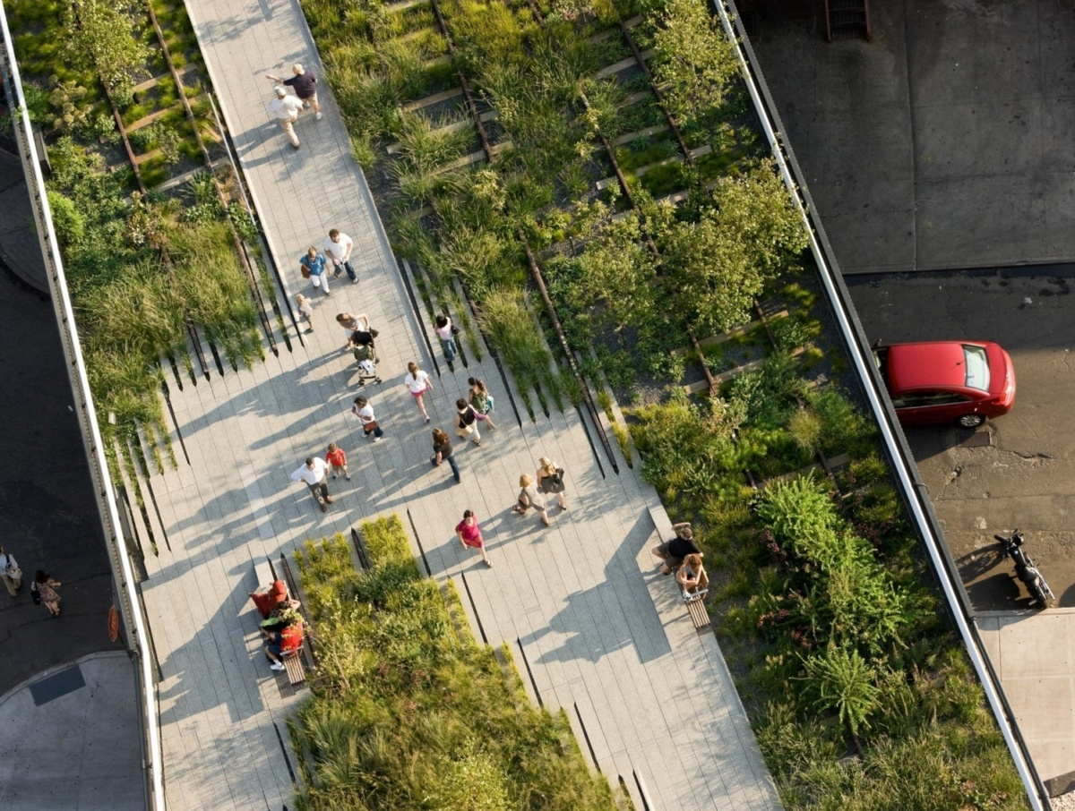 Image of people walking in elevate railway park with shrubs