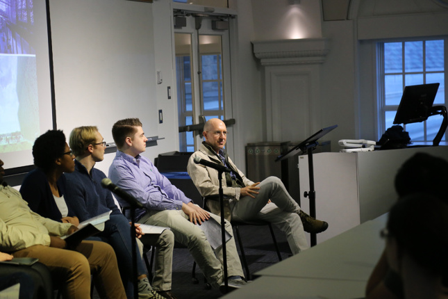 Photo of panel with Oren Safdie and people in classroom