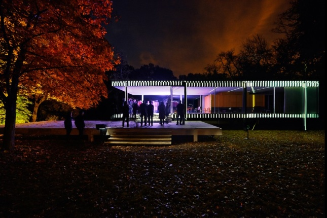 The Farnsworth House illuminated in black-and-white lines, and purple interior lighting