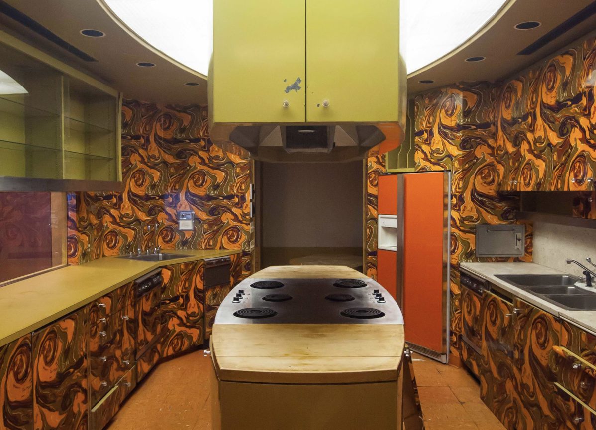 Image of a test kitchen with an orange and yellow psychedelic interior