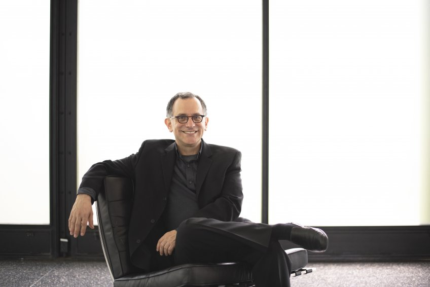 Photo of Reed Kroloff sitting in black chair