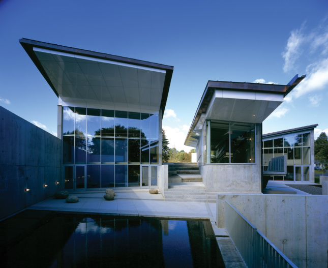 Two steel-and-glass pavilions with sharply angled roof lines