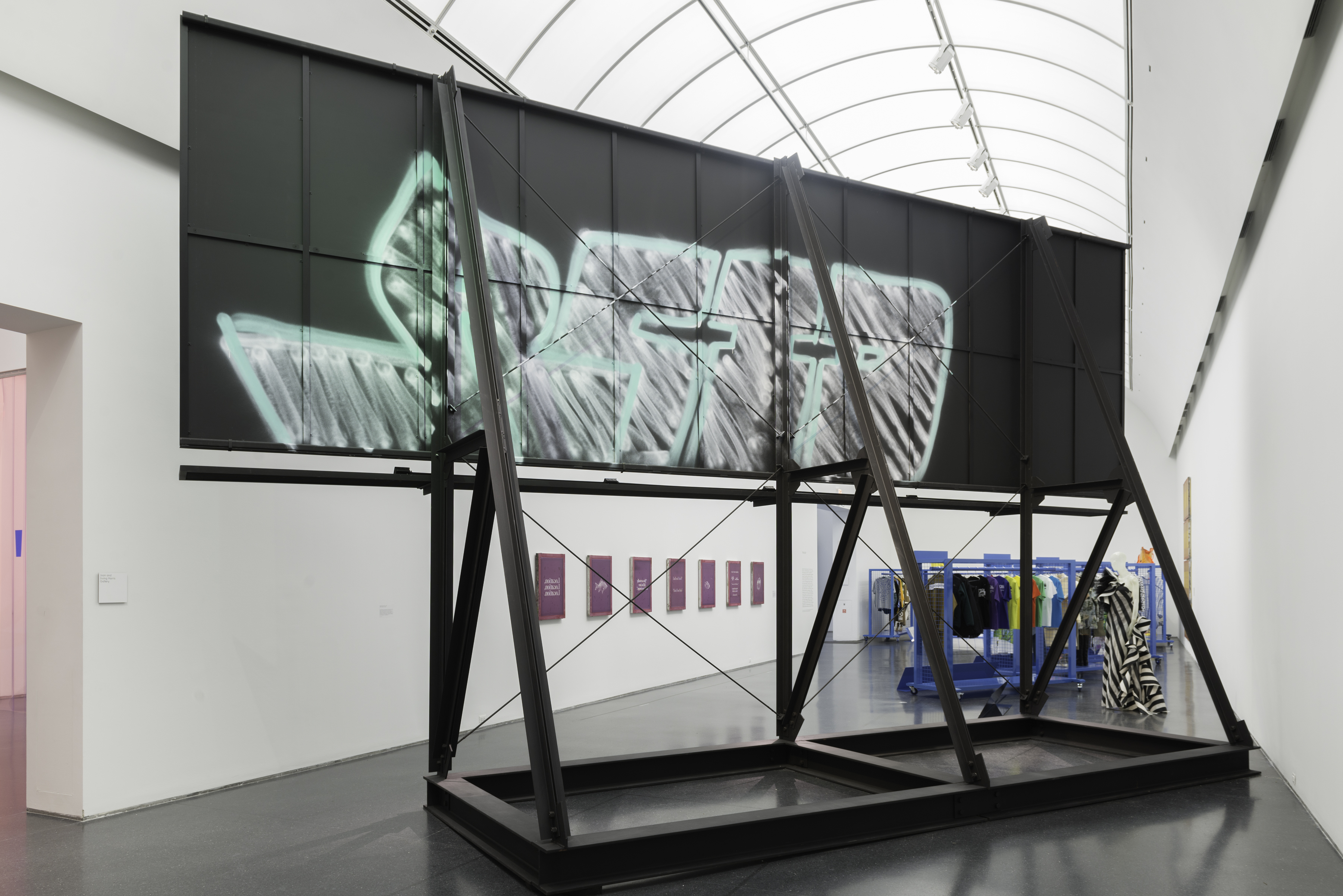 Photo of an artwork by Virgil Abloh made of black steel structure and graffiti on it