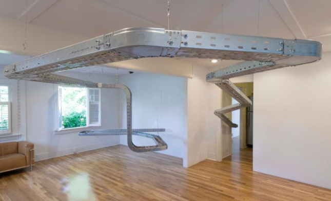 Photo of wire trays snaking around a white gallery