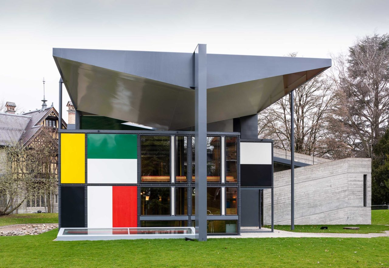 A modernist-style house with a colorful window wall; the Centre Le Corbusier