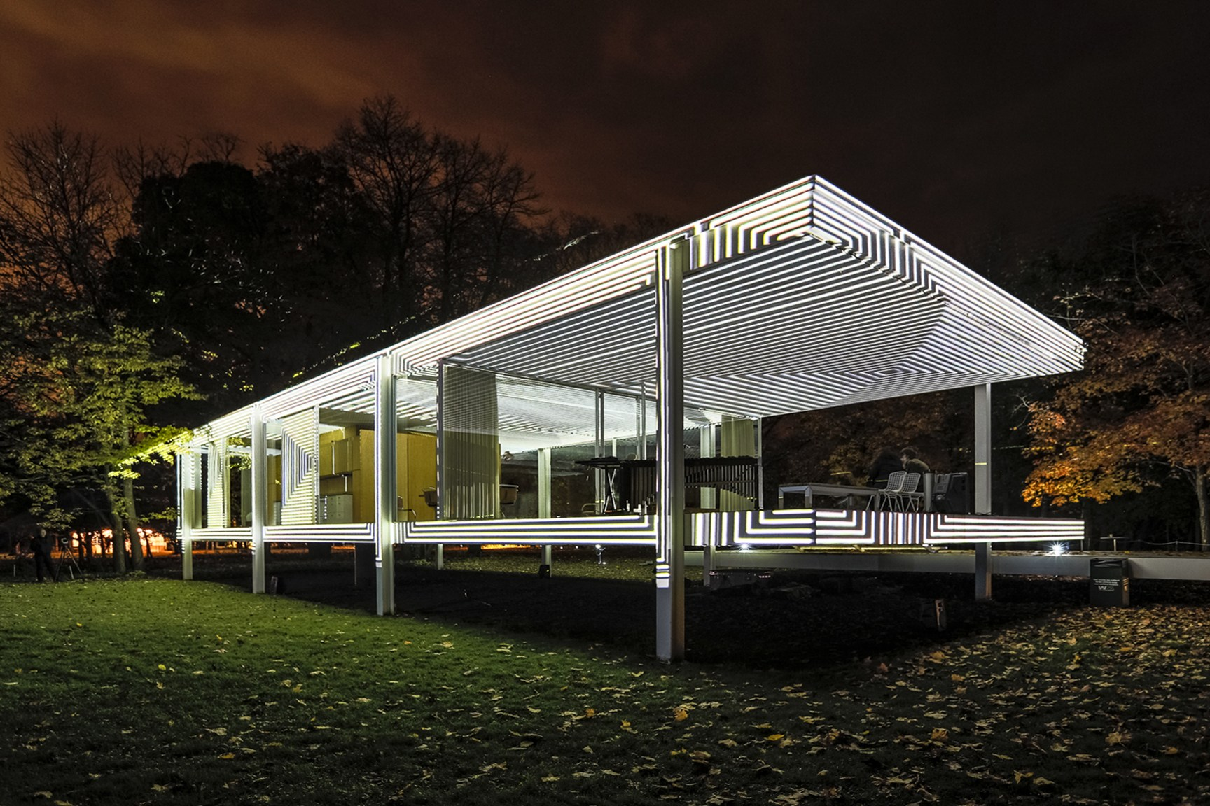 The Farnsworth House projected in black-and-white stripes at night
