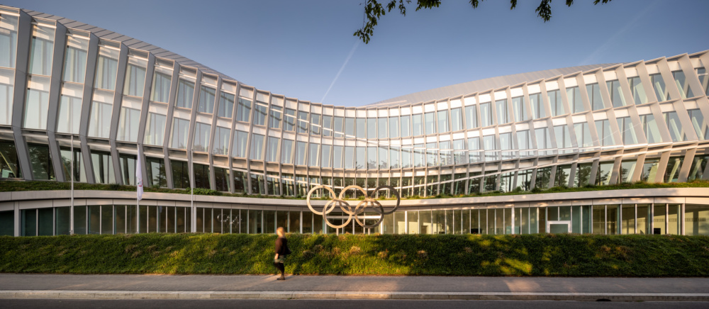 Exterior photo of the Olympic House, a swirling glass facade