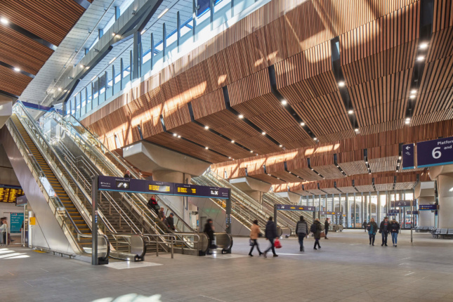 Photo of a rail station with timber-clad interior