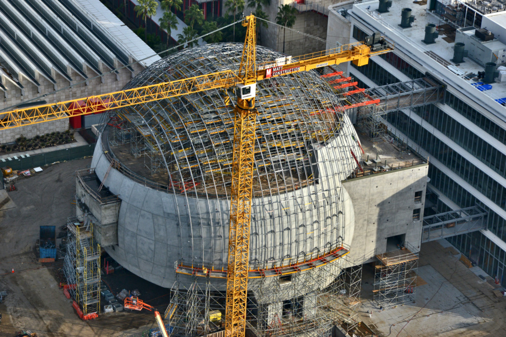 Aerial image of the under construction Academy Museum of Motion Pictures, featuring a giant glass dome