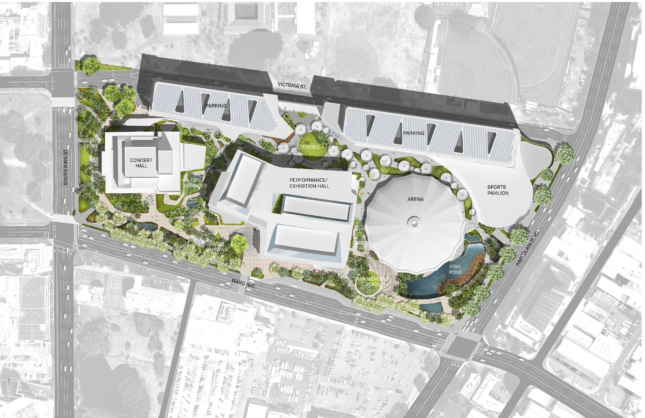 An aerial site plan depicting a round arena, a sports hall, concert venue, and performance space