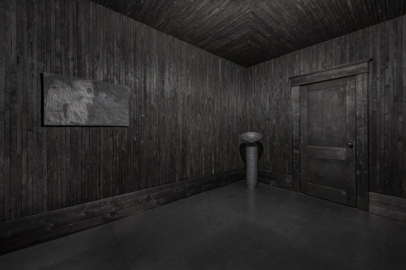 Interior of an all-black tile room, designed by Anders Rohwald