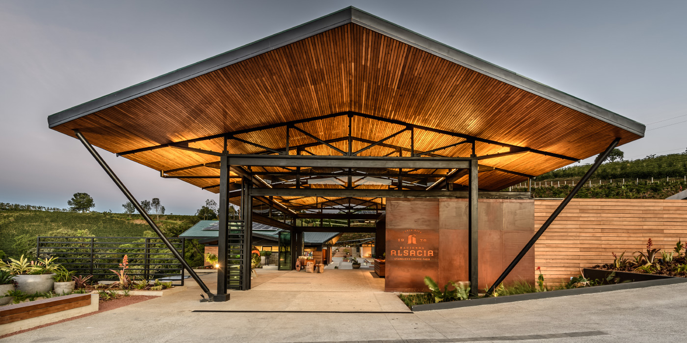 A Starbucks on an open hilltop with a large wooden canopy and open walls