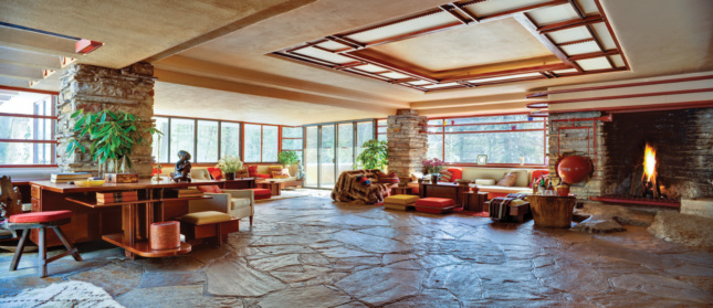 A panorama photo of a flat living area with a natural stone floor and open plan