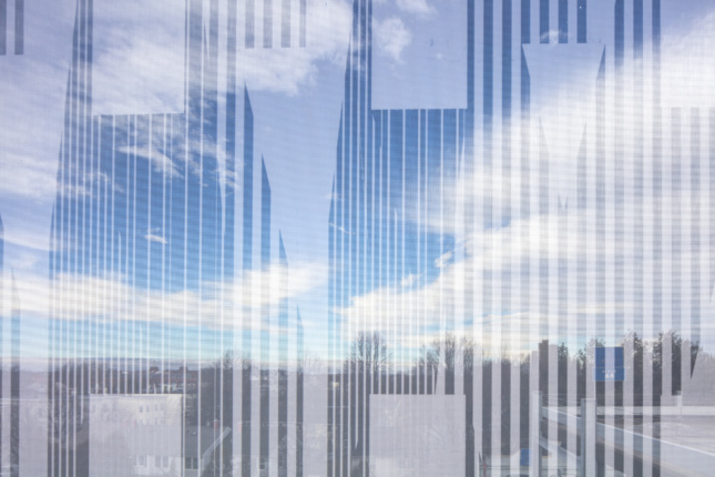 Detail of a vertically-oriented facade graphic